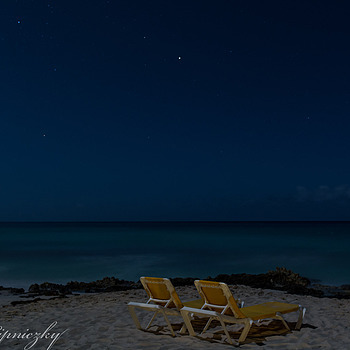 Two beach chairs in the moonlight | ZEISS DISTAGON F2.8 21MM <br> Click image for more details, Click <b>X</b> on top right of image to close