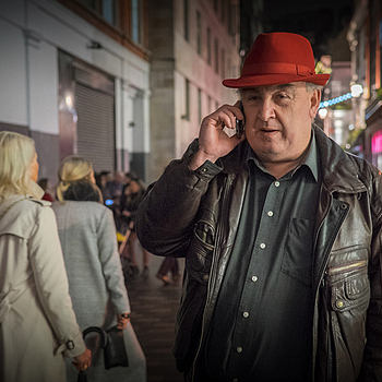 Man with red hat | ZEISS TOUIT F1.8 32MM <br> Click image for more details, Click <b>X</b> on top right of image to close