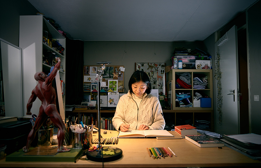 Cartoonist in her studio | LENS MODEL NOT SET <br> Click image for more details, Click <b>X</b> on top right of image to close