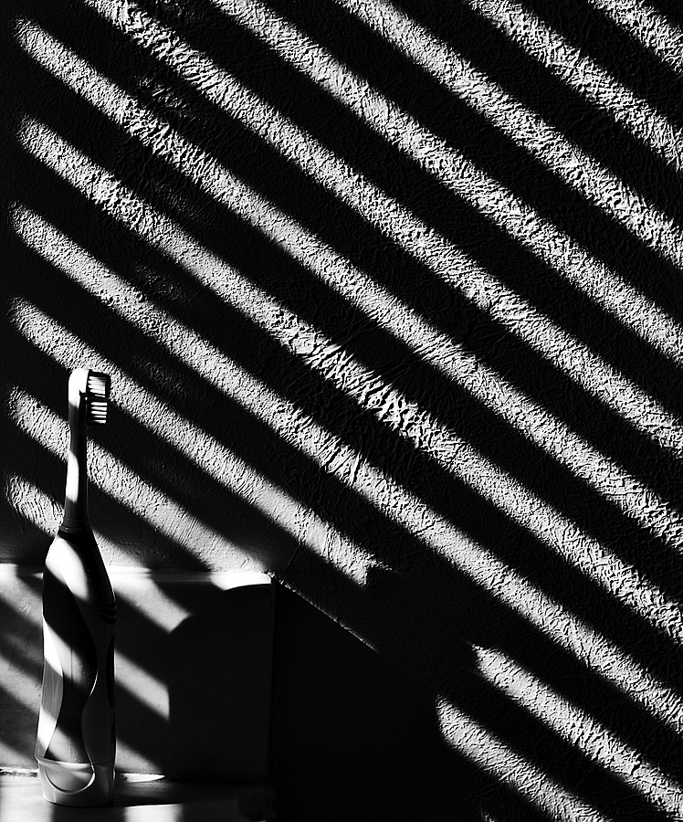 Light, shadow and a toothbrush | ZEISS MILVUS 100MM F2 <br> Click image for more details, Click <b>X</b> on top right of image to close