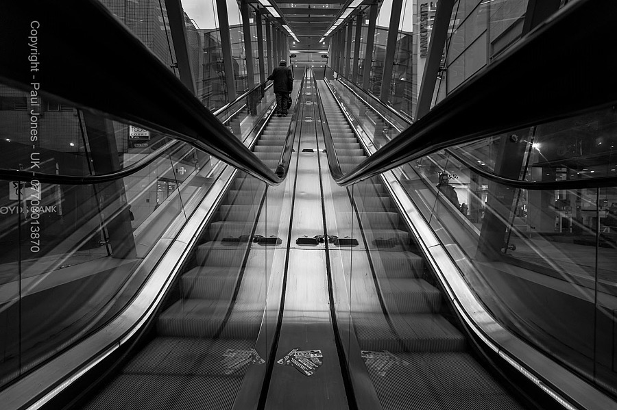 Man on Escalator - Manchester UK | ZEISS ZM DISTAGON F2.8 15MM <br> Click image for more details, Click <b>X</b> on top right of image to close