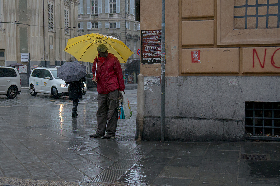 Umbrella man | ZEISS VARIO-TESSAR 16-70MM F4 ZOOM <br> Click image for more details, Click <b>X</b> on top right of image to close
