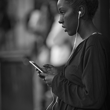 Texting while waiting | ZEISS APO SONNAR F2 135MM <br> Click image for more details, Click <b>X</b> on top right of image to close
