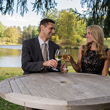 Portrait of engaged couple drinking wine by the lake | ZEISS DISTAGON 35MM F1.4 FE ZA <br> Click image for more details, Click <b>X</b> on top right of image to close