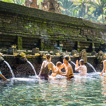 Family Bathing at Holy Water Spring | LENS MODEL NOT SET