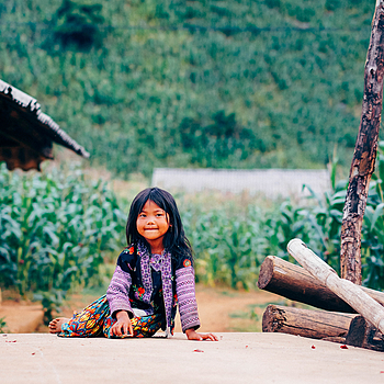 A little girl on mountainous area | LENS MODEL NOT SET