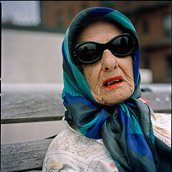 Brighton Beach, woman with sunglasses | ZEISS F PLANAR 110MM F2 <br> Click image for more details, Click <b>X</b> on top right of image to close