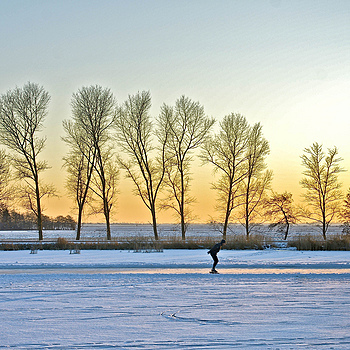 Lonely skater at sunset on the river Waver near Amsterdam | ZEISS ZA VARIO-SONNAR DT F3.5-F4.5 16-80MM <br> Click image for more details, Click <b>X</b> on top right of image to close