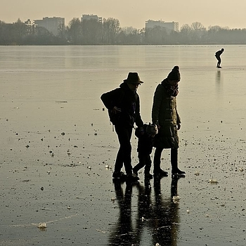 Small family and a lone skater on a lake near Amsterdam (Amstelveense poel) | LENS MODEL NOT SET <br> Click image for more details, Click <b>X</b> on top right of image to close